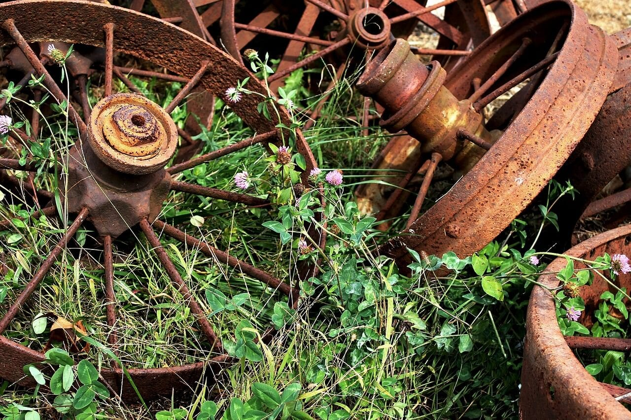 Close up of old rusty wheel trims on grass