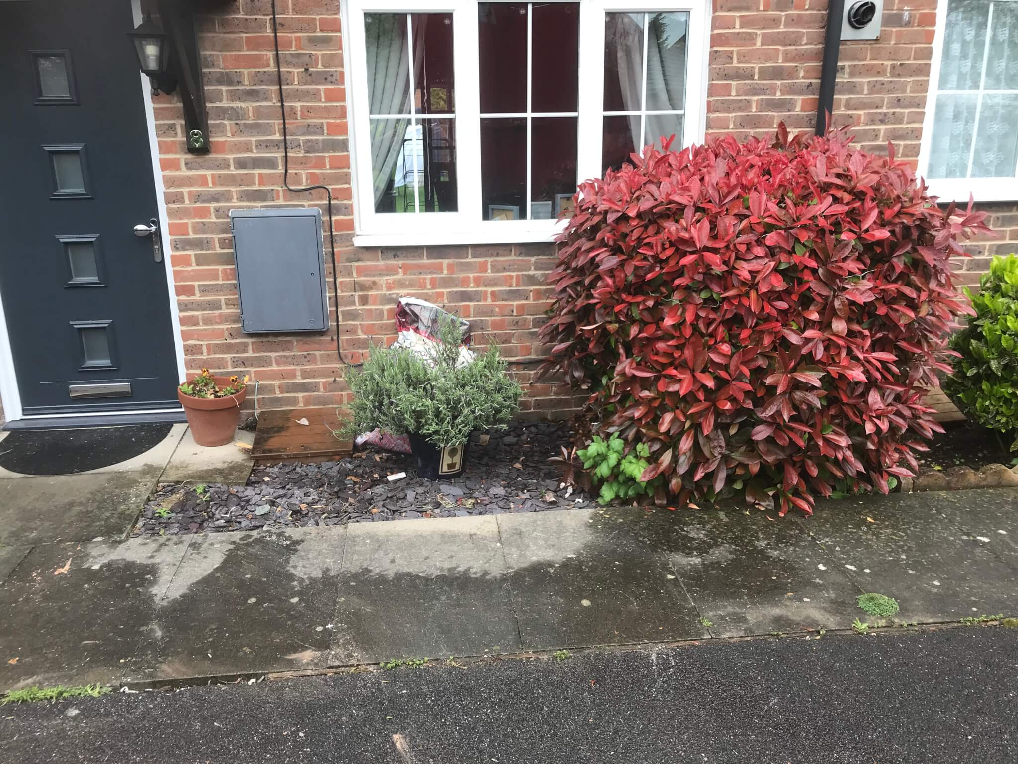 Cleared front garden after old bathroom suite has been removed